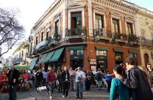 coffee shops in San Telmo. Couple dancing tango in the street